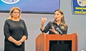 ?? PEDRO PORTAL/MIAMI HERALD VIA AP ?? Nikki Fried, Florida Commission­er of Agricultur­e and Consumer Services, speaks as state Sen. Janet Cruz, left, D-Dist. 18, listens during a news conference Tuesday at the Manatee County Public Safety Building in Bradenton, Fla.