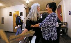 ??  ?? Lena Belle Valencia Morgan, left, Santa Fe High School Class of 1961, greets Beatrice Chavez Ortiz, SFHS Class of 1960, at a reunion Friday.