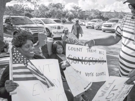 ?? JAHI CHIKWENDIU/THE WASHINGTON POST ?? Demonstrators gather outside the Broward County Supervisor of Elections headquarters as election workers sorted and recounted ballots. In his failed bid for reelection, Sen. Bill Nelson (D) said without evidence that Russians had access to the state's election systems.