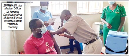 ??  ?? ZVIMBA District Medical Officer Dr Terrence Dandazi receives his jab at Banket District Hospital yesterday morning