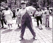 """?? Robert Cohen/The Commercial Appeal files ?? Lee Brown dances to the music of a gospel group in Court Square in this 1991 photograph. """"I was drunker than Cooter Brown. There were spirits from the bottle and spirits from the music and we got together to dance. I think you can say I was spirited.""""..."""