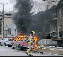 ?? Photo courtesy Sam Livermore ?? firefighters attend the scene of a car fire at the corner of 4th avenue and 5th street n.E. on Wednesday. The car was found fully engulfed.