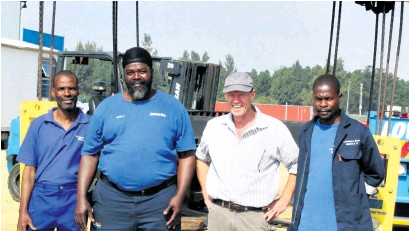 ?? Tamlyn Jolly ?? Celebrating the official opening of the warehouse in the RBIDZ complex are Lovemore Bros employees Eric Nxumalo (rigger driver), Isaak Ngcobo (rigger's assistant), Bruce Lovemore (joint CEO) and Mandla Hobe (rigger's assistant)