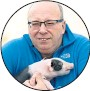 ??  ?? Farmer Kevin Gilbert with piglet