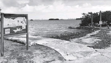 ?? LINDA ROBERTSON lrobertson@miamiherald.com ?? The boat ramp adjacent to Legion Park is blighted with seaweed and trash and has been closed since 2009.