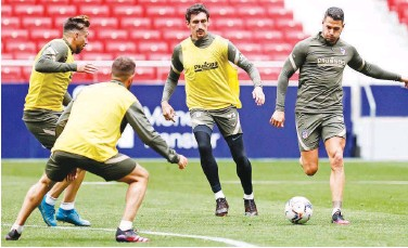 ?? Courtesy: Atletico Madrid website ?? ↑ Atletico Madrid players attend a training session on Friday, ahead of their Spanish League match against Eibar.