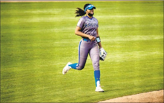 ?? Photographs by Gina Ferazzi Los Angeles Times ?? UCLA's Maya Brady is one of the top hitters for the second-ranked Bruins. The Oaks Christian High graduate has nine home runs with 25 RBIs and a .309 average.