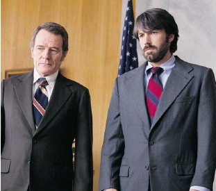 ?? WARNER BROS. ?? STONE'S #1 PICK: ARGO Bryan Cranston, left, stars as Jack O'Donnell and Ben Affleck as Tony Mendez in Argo, a rescue thriller about the 1979 Iranian hostage crisis.