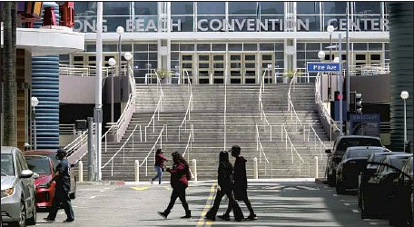 ?? Luis Sinco Los Angeles Times ?? LONG BEACH has offered the city's Convention Center to the Biden administration as a possible shelter for unaccompanied immigrant children who have recently arrived at the U.S.-Mexico border. Sibling pairs as young as 3 years old could arrive as early as this week.