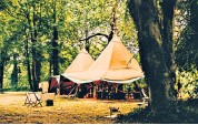 ??  ?? i 'Glamping' tents such as Cloud Nine's are like hotel rooms dropped into the woods and fields of the country's great estates