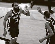 ?? Adam Hunger / Associated Press ?? James Harden , left, and Kevin Durant combined for 64 points on Monday night.