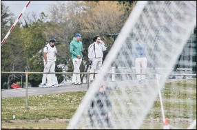 ?? Pic: Daniel Haswell ?? WATCHING ON Cricketers look on as USP take on Binfield