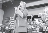 """?? JUSTIN SULLIVAN, GETTY IMAGES ?? """"Republicans want ... to go back to trickle-down economics,"""" Clinton said during a rally at George Mason University in Fairfax, Va., on Monday."""