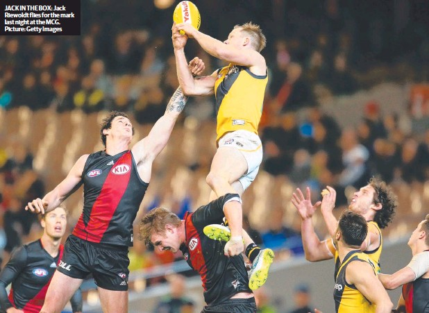 ??  ?? JACK IN THE BOX: Jack Riewoldt flies for the mark last night at the MCG. Picture: Getty Images