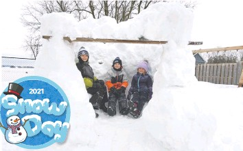 ?? Submitted ?? Dylan, Ethan and Olivia Koebel from Heidelberg created their huge Snow Fort on their snow day, February 22.