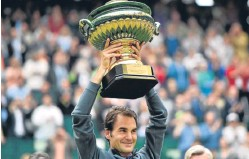 ??  ?? Roger Federer with the Gerry Weber Open silverware.