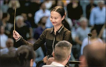 """?? Jason Armond Los Angeles Times ?? TIANYI LU energized """"The Star-Spangled Banner"""" during her debut at the Hollywood Bowl this summer."""