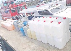 ??  ?? The petrol in containers seized by the General Operations Force in the waters near Bohayan Island.