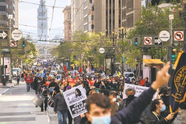 ?? Photos by Santiago Mejia / The Chronicle ?? Hundreds of labor union workers and their supporters march up Market Street in S.F. to mark May Day.
