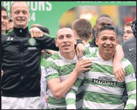 ?? SNS. ?? Celtic players celebrate after the final whistle.