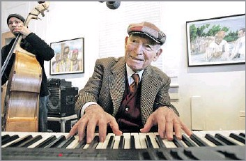"""?? Associated Press ?? CO-FOUNDED NEWPORT JAZZ AND FOLK FESTIVALS George Wein, seen playing at the New Orleans Jazz & Heritage Festival in 2008, """"can justifiably claim to have invented, developed and codified the contemporary popular music festival,"""" a music critic wrote."""