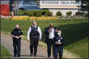 ?? JULIO CORTEZ — THE ASSOCIATED PRESS ?? Police walk near the scene of a shooting at a business park in Frederick, Md., on Tuesday.