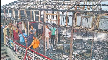?? ANI ?? Firefighters at the site of the massive fire that broke out in the cash counting room near the Vaishno Devi temple in Katra, Jammu & Kashmir, on Tuesday. Officials said prima facie it appeared to be the result of an electrical short circuit. They said the structure was gutted in the incident near the cave shrine but there were no casualties.