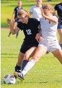 ?? JIM THOMPSON/JOURNAL ?? La Cueva's Hannah Rivera, left, battles for the ball with Academy's Maya Land on Saturday at Academy.