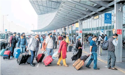 ?? Photo / Bloomberg ?? Travellers from India are temporaril­y banned from entering New Zealand from today.