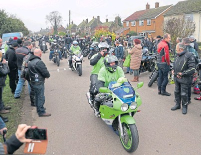 ??  ?? POIGNANT: A motorbike convoy makes its way through the village of Charlton in memory of Harry Dunn