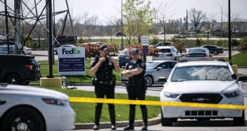 ??  ?? Police officers stand behind caution tape near a crime scene in Indianapolis, Indiana. — AFP photo