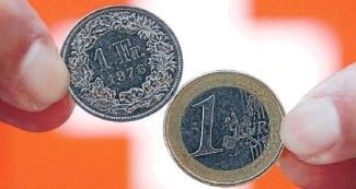 ??  ?? ''Told you so's'': A Swiss 1 franc coin, left, and a 1 coin. The Swiss franc surged after their euro control was abandoned.