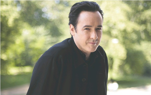 ?? SHAUN CURRY / AFP via Getty Images ?? Veteran actor John Cusack says he took on his first small screen role because he couldn't turn down a chance to work with author Gillian Flynn.