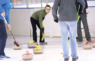 ?? PHO­TOS BY MARLA BROSE/JOUR­NAL ?? Al­li­son Tutton, sec­ond from left, watches a stone as her team, Fool House Rock, com­petes against Curls Just Wanna Have Fun on a re­cent Satur­day.