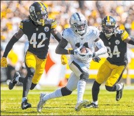 ??  ?? Raiders receiver Henry Ruggs outruns Steelers defenders James Pierre (42) and Terrell Edmunds for a 61-yard touchdown Sunday. Ruggs finished with five receptions for 113 yards.