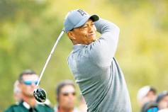 ?? - AFP photo ?? Tiger Woods plays his shot from the 18th tee during the first round of the Valspar Championship at Innisbrook Resort Copperhead Course on March 8, 2018 in Palm Harbor, Florida.