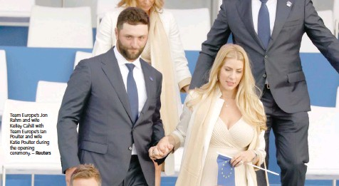?? — Reuters ?? Team Europe's Jon Rahm and wife Kelley Cahill with Team Europe's Ian Poulter and wife Katie Poulter during the opening ceremony.