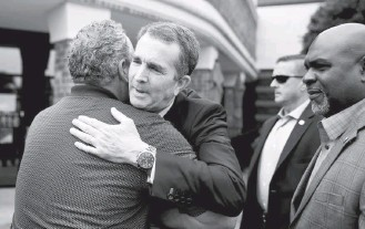 ?? CHIP SOMODEVILLA/GETTY IMAGES ?? Virginia Gov. Ralph Northam embraces a mourner during a prayer service for the victims of the mass shooting in Virginia Beach. Last week, Northam ordered a special legislative session on gun control.