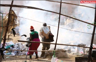 ?? Harare, yesterday Pic: Shepherd Tozvireva ?? An illegal vendor attempts to douse a tearsmoke canister which had been thrown near her merchandise with water as police dispersed people at the open area near Mupedzanhamo flea market in Mbare,