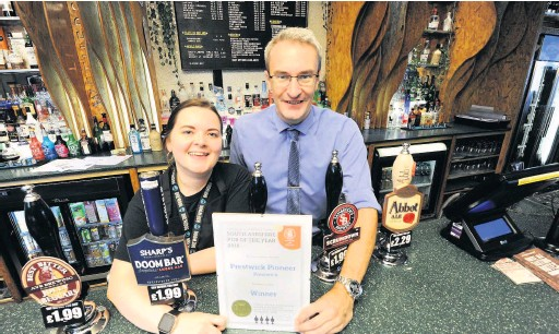 ??  ?? Cheers Pictured are Euan Scott, manager with staff member Lizi Clark
