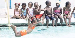 ?? FILE ?? Scores of children learn to swim at the National Stadium swimming pool, which has not been certified by the Ministry of Health.