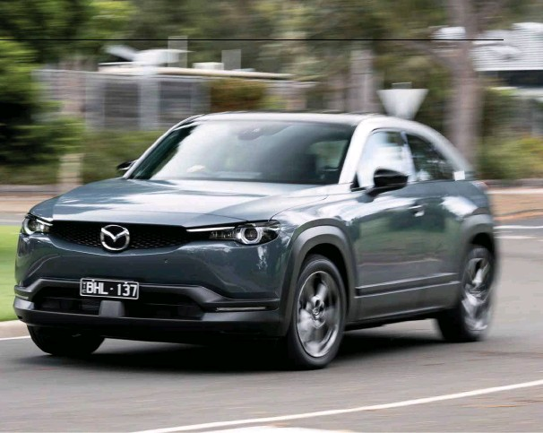 ??  ?? Opposite: MX-30 advances the Mazda interior game even further, shifting HVAC controls to a new 7.0-inch TFT screen