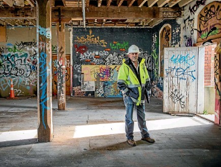 ?? PHOTO: DAVID WALKER/STUFF ?? Structural engineer Michael King is the new owner of Wood Brothers Mill in Addington, Christchurch.