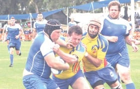 ?? (David Silverman/Courtesy) ?? RUGBY HAS been a niche sport in Israel for a long time but is hoping to garner more mainstream appeal. Above, the National Team (in blue) tackles Andorra in a match.