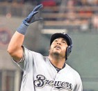 ?? GETTY IMAGES ?? Jesus Aguilar celebrates a solo home run in the third inning, one of three HRs by the Brewers.
