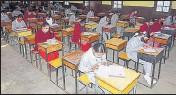 ?? DEEPAK SANSTA / HT ?? Students appearing for Himachal Pradesh Board examination at Government Senior Secondary Girls school, Lakkar Bazar, Shimla, on Tuesday.