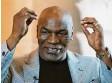 ?? Foto: dpa ?? Ohrenbeißer Mike Tyson steigt wieder in den Ring.