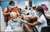 ?? PTI ?? A beneficiary receive the first dose of COVID-19 vaccine, at a government dispensary, in Patna, on Tuesday