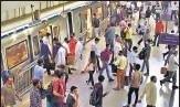 ?? RAJ K RAJ/HT ?? Commuters at a Metro station in New Delhi on Monday.