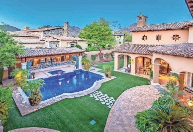 ?? COURTESY OF ANDREW BLOOM OF KELLER WILLIAMS ARIZONA REALTY ?? This mansion has a Venetian tiled pool and a poolside cabana.